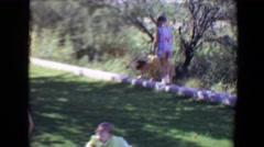 1967: outdoor party walking garden play enjoyment talking family TUCSON, ARIZONA Stock Footage