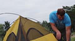Traveler sets a tent for the night Stock Footage
