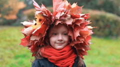 Close-up portrait of happy smiling beautiful cute little girl in a wreath crown Stock Footage