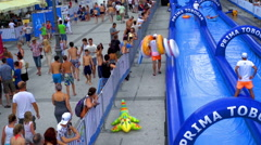 Two lifeguards are working on the water slides Stock Footage