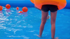 Orange ballons and orange swim rings Stock Footage