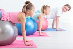 Two little girls and their physiotherapist Stock Photos