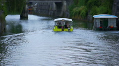 Yellow boat is sailing towards a bridge Stock Footage