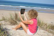 Young blond woman make selfie at the beach. Stock Photos