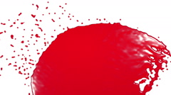 Red fluid stream hits a surface. syrup Stock Footage