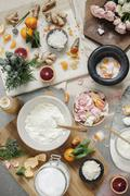 Overhead view of a pestle and mortar and rose petals, ginger and oranges Stock Photos