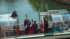 Music band is performing classical music on a small boat Stock Footage