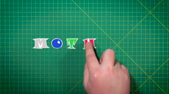 Man puts letters the word mother Stock Footage