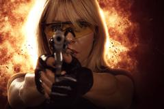 Woman with gun Kuvituskuvat