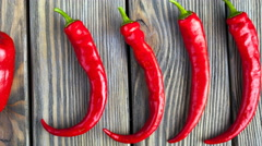 Red hot chili peppers on wood background Stock Footage