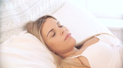 Pregnant  woman sleeping restlessly on bed Stock Footage