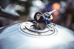 Fuel tank of motor bike with keys Stock Photos