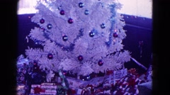 1968: christmas tree decorated beautiful presents kept boy sitting surprised Stock Footage