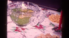 1968: christmas dinner punchbowl, red and green tablecloth and cakes, cupcakes Stock Footage