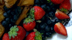 Beautiful berries with croissants on the plate Stock Footage