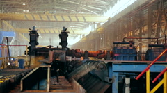Ironworks plant. Working Machines moves burning hot billet Stock Footage