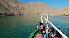 People on a pleasure boat near the coast of Musandam peninsula in Oman Stock Footage