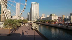 Ferris wheel near Al Qasba canal in Sharjah city, United Arab Emirates Stock Footage