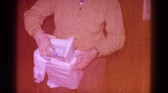 1968: christmas scene mother cheered indoor party, presents Stock Footage