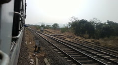 Indian Railways 10. Shot from window of last car on turning tracks Stock Footage