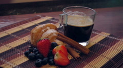 Coffee with croissent and berries on a wooden table Stock Footage