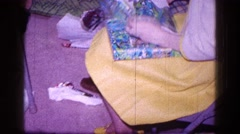 1968: children sitting on the floor and unwrapping the presents MINNESOTA Stock Footage