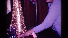 1968: christmas scene mother cheered indoor party  Stock Footage
