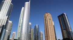 Almas tower and Jumeirah Lakes Towers, Dubai Multi Commodities Centre, UAE Stock Footage