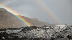 Brilliant bright double rainbow over Solheimar glacier mountain Iceland Stock Footage