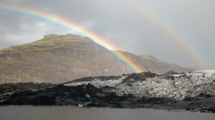 Brilliant bright double rainbow over Solheimar glacier mountain lagoon Iceland Stock Footage
