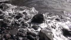 Waves on stony beach Stock Footage