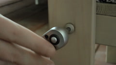 Man spins the screw with a screwdriver Stock Footage