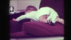 1942: baby crawls over couch cushions towards fragile object NEW YORK Stock Footage