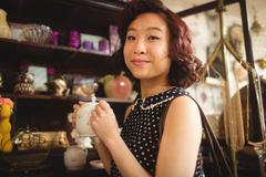 Portrait of stylish woman selecting a tea pot Stock Photos