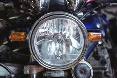 Headlight of motorcycle Stock Photos