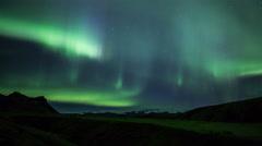 Aurora borealis northern lights over snow ice cap glacier Iceland realistic 4k Stock Footage