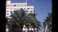 1951: huge building with many stories is lying behind palm trees FLORIDA Stock Footage