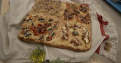 Beautiful flat loaf arranged with tomatoes and spices Stock Footage