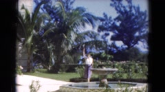 1951: outdoor, woman next to the fontain Stock Footage