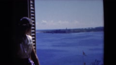 1951: a beautiful young lady sitting in an open window  Stock Footage