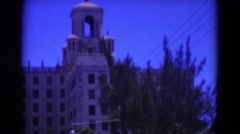 1951: large ornate building with two domes and green front lawn FLORIDA Stock Footage