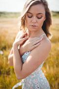 Woman feeling the breeze Stock Photos