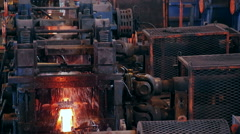Ironworks plant. Working Machines. Borning Hot Beams. Closeup Stock Footage