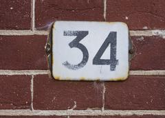 House number 34 Stock Photos