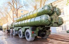 Anti-aircraft missile system (SAM) S-300 parked up on the city street Stock Photos