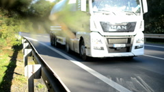 Detail of crash barrier with speeding cars, three times acceleration Stock Footage
