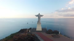 Statue of Cristo Rei, Madeira at evening aerial view Stock Footage