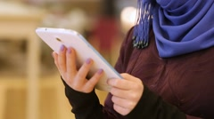 Beautiful Islamic woman with electronic tablet in the hands Stock Footage