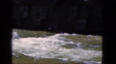 1964: a beautiful raging river cutting through a rugged mountain  Stock Footage