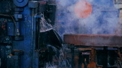 Ironworks plant. Burning Hot Billet moving through Machine Stock Footage